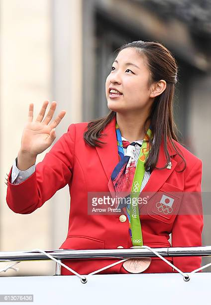 Nozomi Okuhara waves on the top of a double decker bus during the Rio Olympic Paralympic 2016 Japanese medalist parade in the ginza district on...