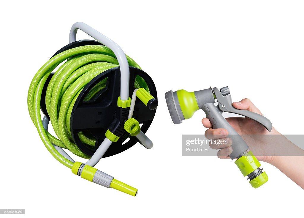 Nozzle of a garden water hose and garden sprayer : Stock Photo