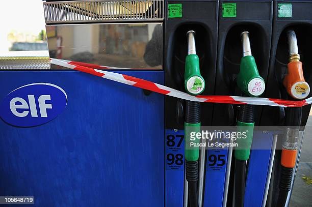 Nozzles of a petrol pump are seen at an empty Elf gas station on October 18 2010 in Paris France More than 900 gas stations across France have run...