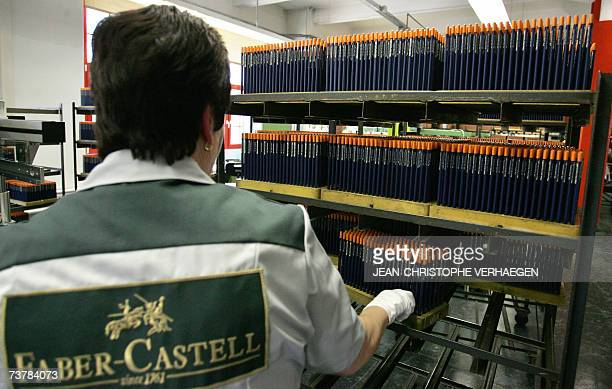 An emplyee checks finished pencils 16 March 2007 in Stein near Nuremberg at the FaberCastell plant at the headquarters of the German manufacturer of...