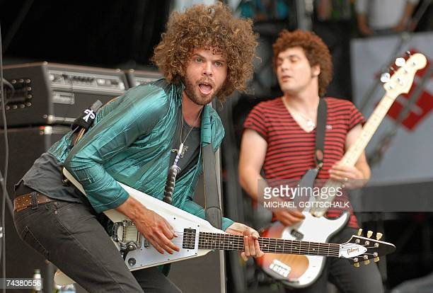 """Andrew Stockdale and Chris Ross of the band """"Wolfmother"""" performs on stage 02 June 2007 during the music festival """"Rock am Ring"""" in Nuremberg,..."""