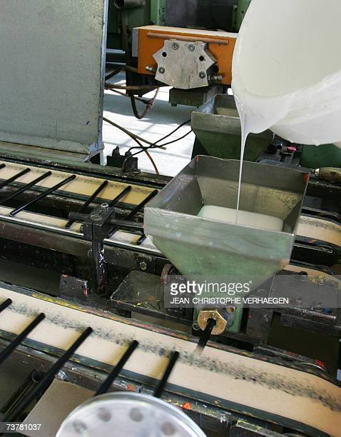 Black colouring pencils are coated with paint 16 March 2007 in Stein near Nuremberg at the FaberCastell plant at the headquarters of the German...