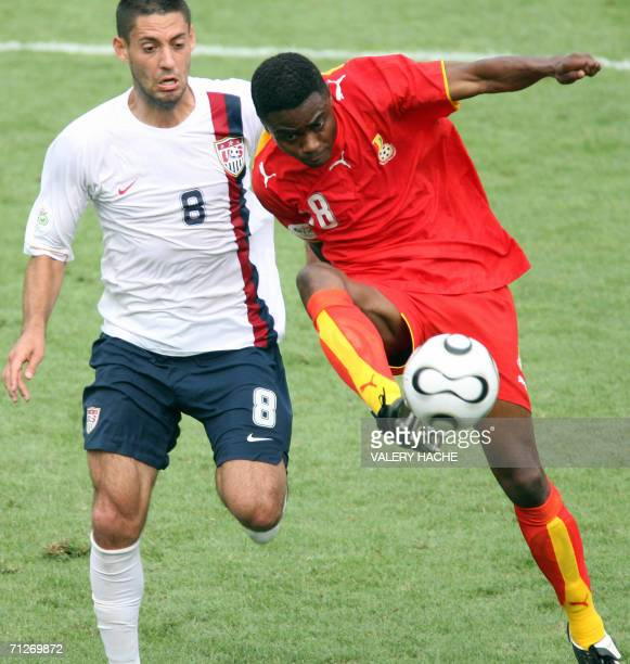 Ghanaian midfielder Eric Addo is challenged by US midfielder Clint Dempsey in the opening round Group E World Cup football match between Ghana and...