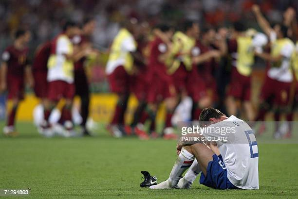 Dutch defender Andre Ooijer looks dejected at the end of the World Cup 2006 round of 16 football game Portugal vs Netherlands 25 June 2006 at...