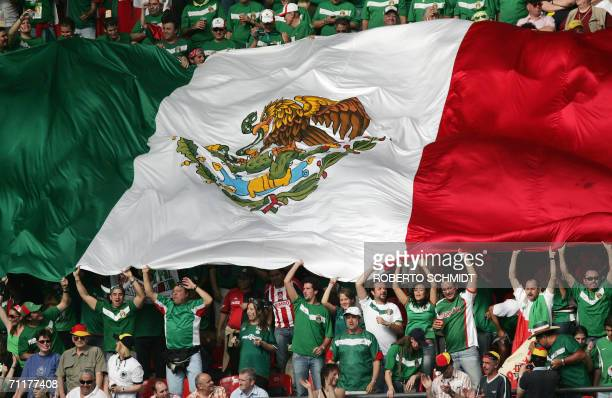 Fans hold up a giant Mexican flag at Nuremberg's Franken Stadium ahead of the first round Group D World Cup football match between Mexico and Iran 11...