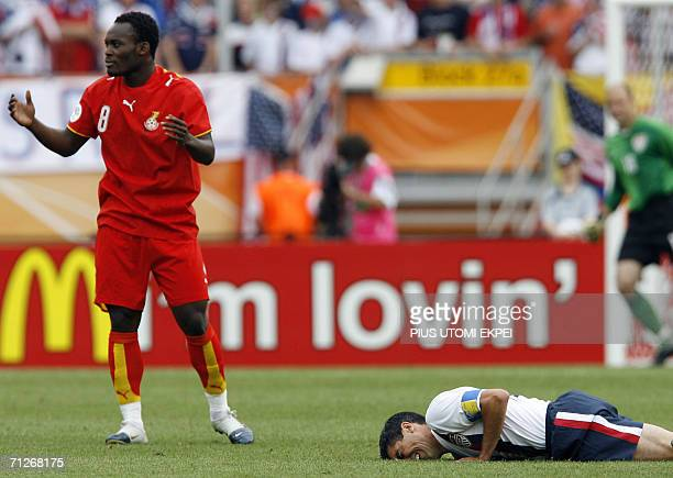 Ghanaian midfielder Michael Essien protests after fouling US midfielder Claudio Reyna during the opening round Group E World Cup football match...