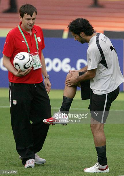Iranian injured defender Sattar Zare who will miss the match against Mexico checks his injured knee during a training session at Nurnberg stadium 10...