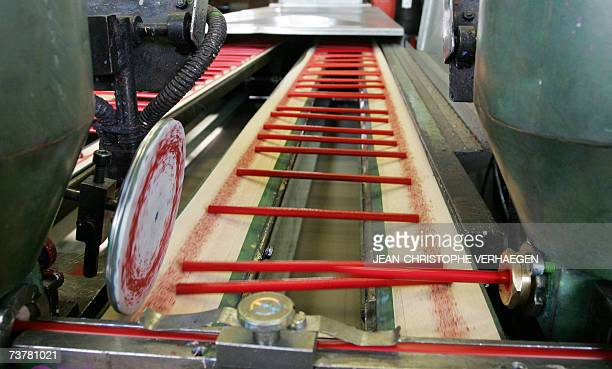 Red colouring pencils are coated with paint 16 March 2007 in Stein near Nuremberg at the FaberCastell plant at the headquarters of the German...