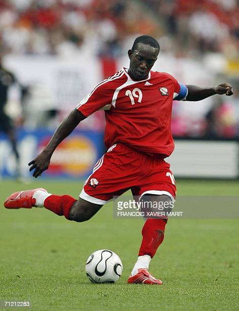 Trinidad and Tobago's forward Dwight Yorke is seen playing against England in their opening round Group B World Cup football match at Nuremberg's...