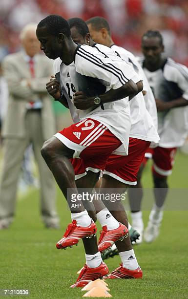 Trinidad and Tobago's forward Dwight Yorke warms up with teammates at Nuremberg's Franken Stadium before the start of the opening round Group B World...