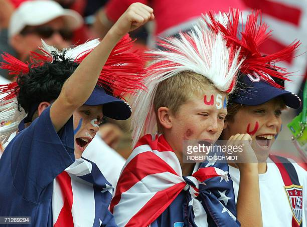 Young US supporters cheer on their team during the opening round Group E World Cup football match between Ghana and the United States at Nuremberg's...