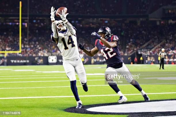 Nsimba Webster of the Los Angeles Rams catches a pass for a touchdown against Jermaine Ponder of the Houston Texans during week four of the preseason...