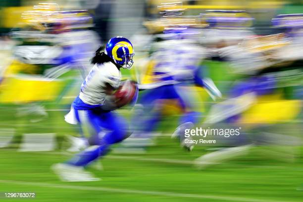 Nsimba Webster of the Los Angeles Rams returns a kickoff in the fourth quarter against the Green Bay Packers during the NFC Divisional Playoff game...