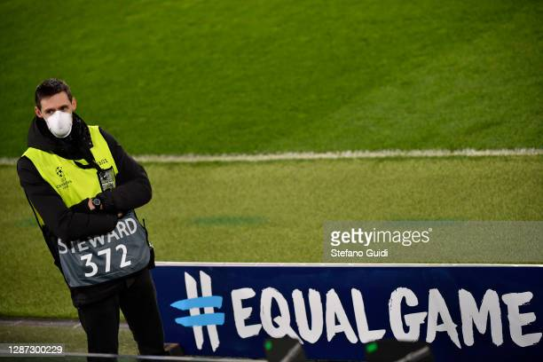 nSteward wear protective mask next to an Equal Game logo during of training session ahead of the UEFA Champions League Group G stage match between...