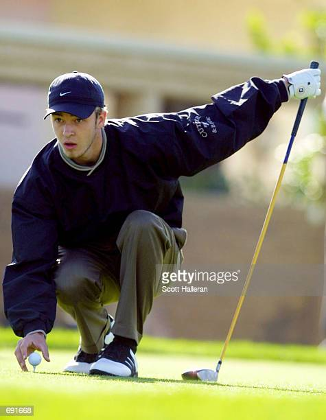 ''NSYNCs Justin Timberlake tees up his ball during the opening round of the Bob Hope Chrysler Classic at Indian Wells Country Club January 16 2002 in...