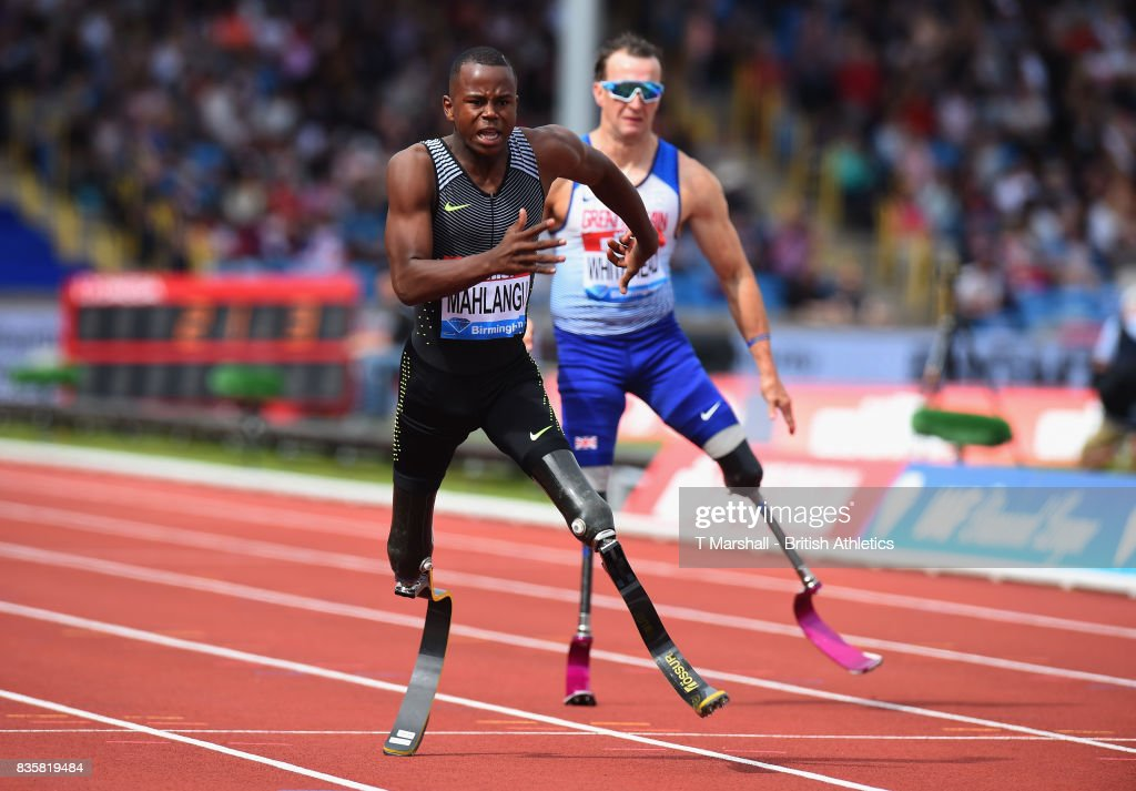Ntando Mahlangu of South Africa wins the Mens T42 200m from Richard Whitehead of Great Britain during the Muller Grand Prix and IAAF Diamond League event at Alexander Stadium on August 20, 2017 in Birmingham, England.