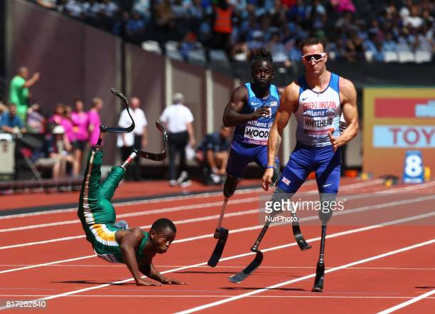 LR Ntando Mahlangu Regas Woods SR Richard Whitehead of Great Britain compete in Men's 100m T42 Round 1 Heat 1during IPC World Para Athletics...