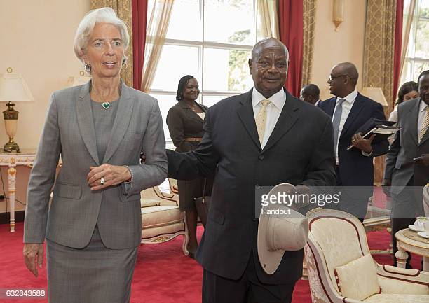 nternational Monetary Fund Managing Director Christine Lagarde and President of Uganda Yoweri Kaguta Museveni walk to the press conference after...