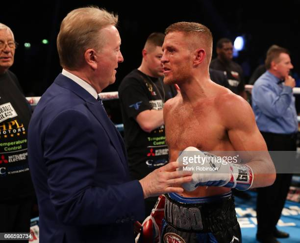'nTerry Flanagan with his promoter Frank Warren after his win over Petr Petrov at Manchester Arena on April 8 2017 in Manchester England