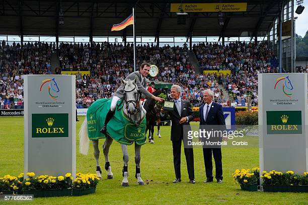 'nThe German rider winner Philipp Weishaupt riding Clooney 51 the Rolex Grand Prix of Aachen in 2016'nduring the prizegiving ceremony'nJuly 17 2016...