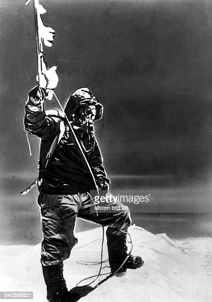 TENZING NORGAY 1953 /nThe sherpa guide Tenzing Norgay at the peak of Mount Everest Norgay with Sir Edmund Hillary was part of the first expedition to...