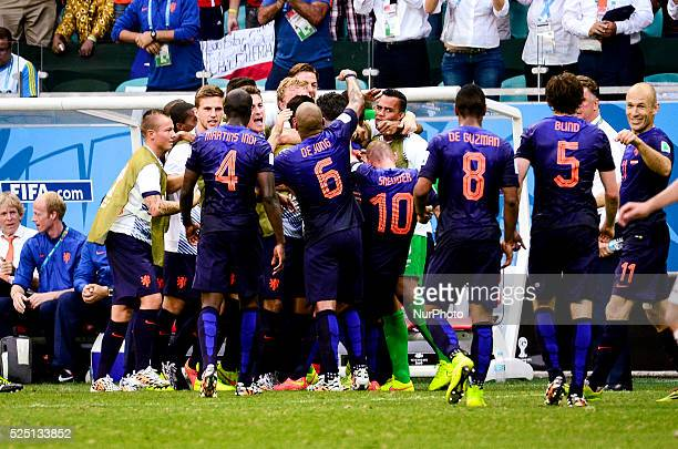 Ntherlands celebrates Sneijder's goal against Spain making 11 at the 2014 World Cup match between Spain and Netherlands in Salvador Brasil this...