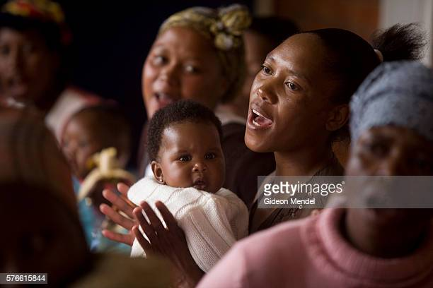Ntsiuoa Ralefifi aged 29 sings at a Mothers2Mothers support group for HIV positive mothers in Mafeteng hospital The song is about the ARV drug...