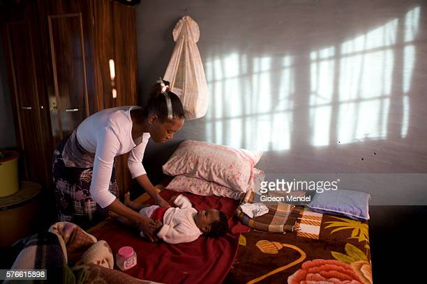 Ntsiuoa Ralefifi changes her eight month old baby girl Nthatisi Nkaota at her home in Harom Hapi Ntsiuoa found out that she is HIV positive when she...