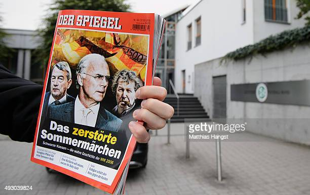 N-tv journalist holds up the latest issue of Der Spiegel magazine in front of the headquarter of the German Football Association on October 17, 2015...