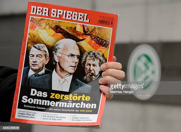 A ntv journalist holds up the latest issue of Der Spiegel magazine in front of the headquarter of the German Football Association on October 17 2015...