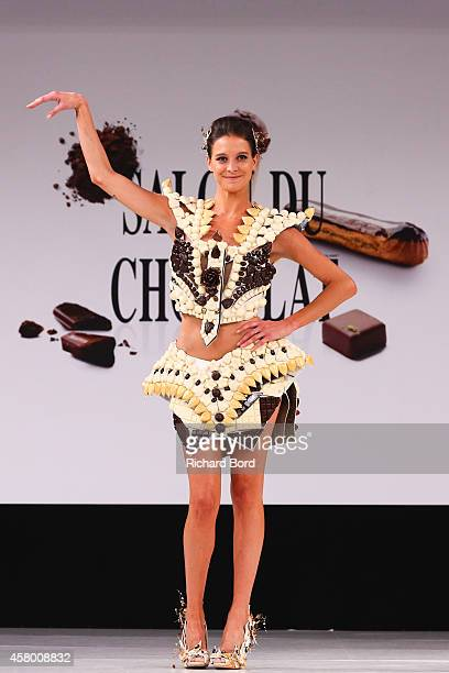 Nubia Esteban walks the runway and wears a chocolate dress made by designer Benjamin Bout and chocolate brand Chocolaterie de Puyricard during the...