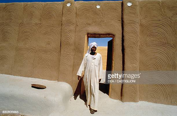 Nubian man at the entrance of a traditional dwelling Wadi Halfa Sudan