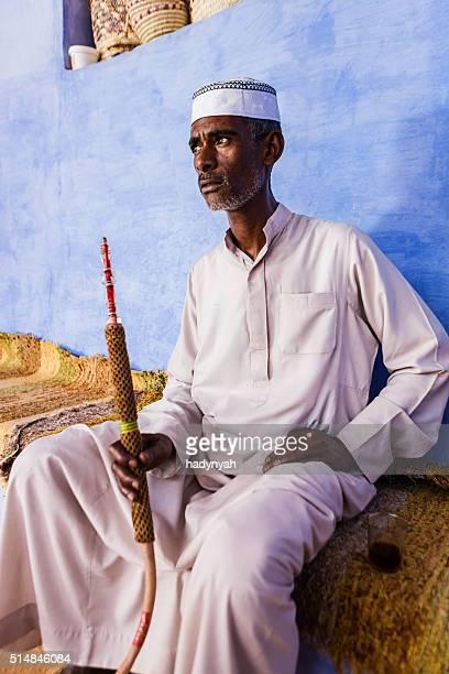 Nubian man smoking  sheesha - waterpipe in Southern Egypt