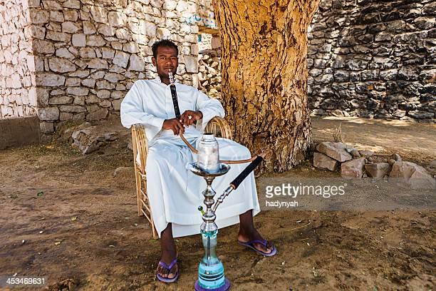 Nubian man smoking waterpipe in Southern Egypt