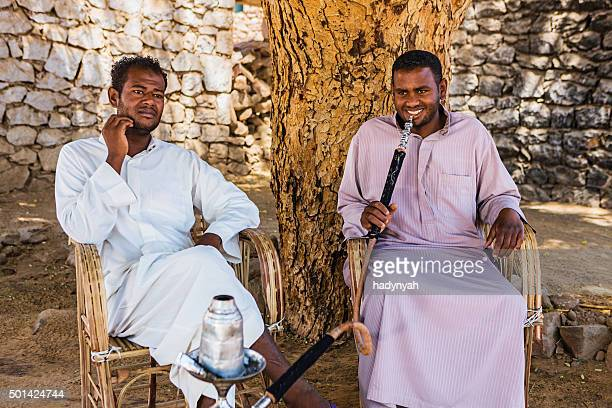 Nubian men smoking waterpipe in Southern Egypt
