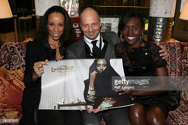Nubya photographer Kai Stuht von Neupauer and Khadija pose during the presentation of the new lambertzcalendar on November 28 2007 at the...