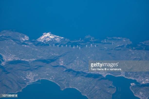 Nuclear and wind power station in Ikata town and Seto Inland Sea in Ehime prefecture in Japan daytime aerial view from airplane