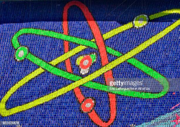 Nuclear atom made by children pixels holding up colored boards during Arirang mass games in may day stadium Pyongan Province Pyongyang North Korea on...