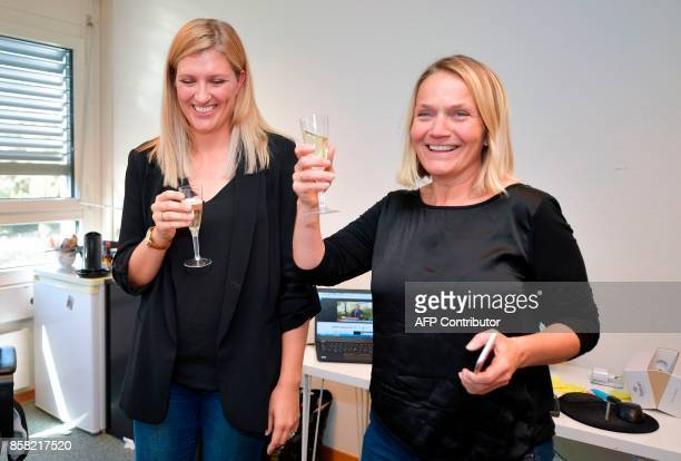 Nuclear disarmament group ICAN executive director Beatrice Fihn and member of the steering committee Grethe Ostern celebrate with champagne after...