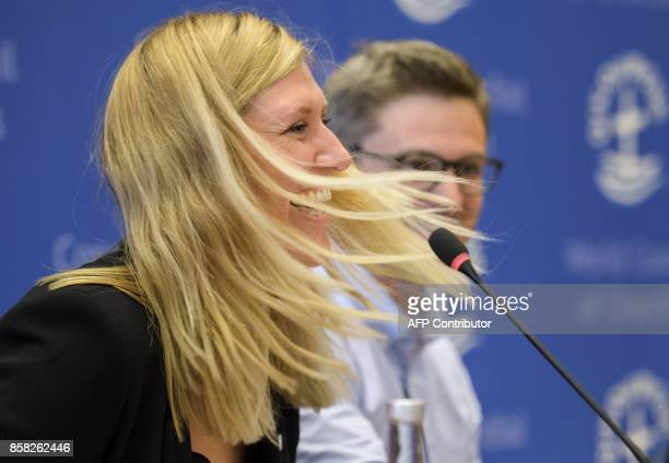Nuclear disarmament group International Campaign to Abolish Nuclear Weapons executive director Beatrice Fihn rects as she speaks next to coordinator...