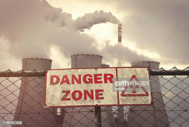 nuclear power plant behind the fence - nuclear reactor stock pictures, royalty-free photos & images