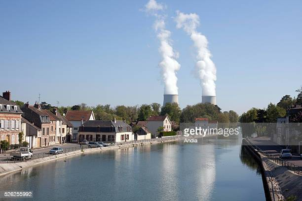 Nuclear Power Plant Nogent Sur Seine operated by EDF for the city by the Seine and crossed off the cooling towers of the Central and white clouds of...