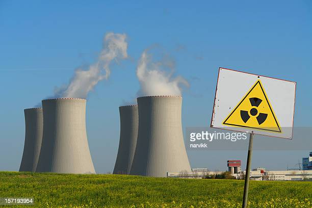 nuclear power plant with radioactivity sign - radioactive contamination stock pictures, royalty-free photos & images