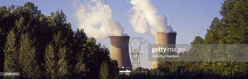Nuclear power plant with trees in foreground : Stock Photo