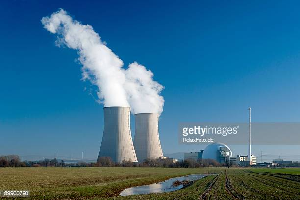 nuclear power station grohnde with steaming cooling towers - cooling tower stock pictures, royalty-free photos & images