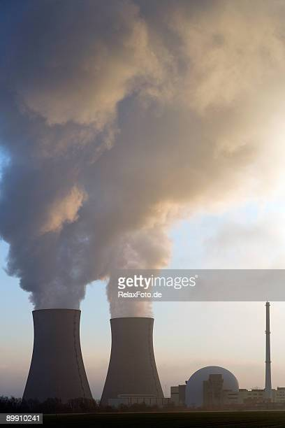 Nuclear power station with steaming cooling towers at sunrise (XL)
