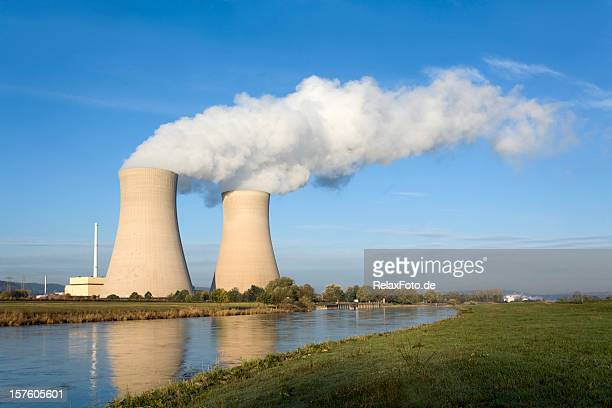 nuclear power station with two steaming cooling towers riverside (xxxl) - nuclear power station stock pictures, royalty-free photos & images