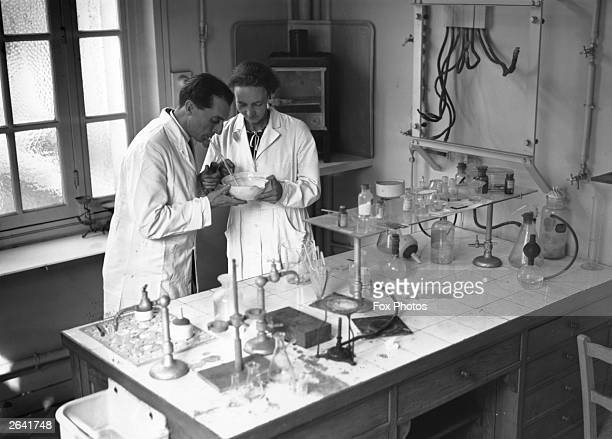Nuclear scientists Frederic and Irene Joliot Curie at work in their laboratory