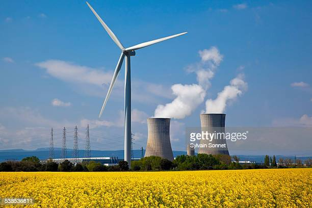 nuclear station and wind turbine - atomic imagery stock pictures, royalty-free photos & images