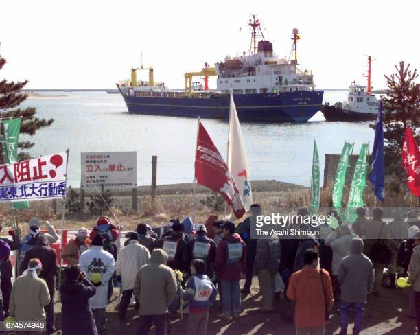 Nuclear transport ship Pacific Teal is seen on arrival at Mutsu Ogawara Port while antinuclear protesters hold a rally on March 18 1997 in Rokkasho...